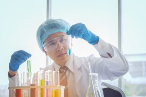 young-male-scientist-in-lab-worker-making-medical-research-in-mo